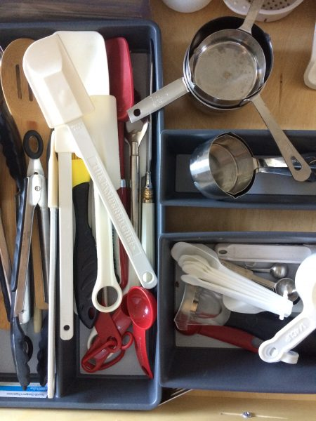 kitchen tools in a drawer organized by type of cooking