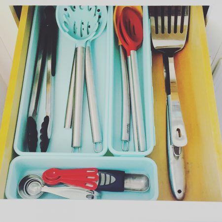 cooking tools organizer in a kitchen drawer