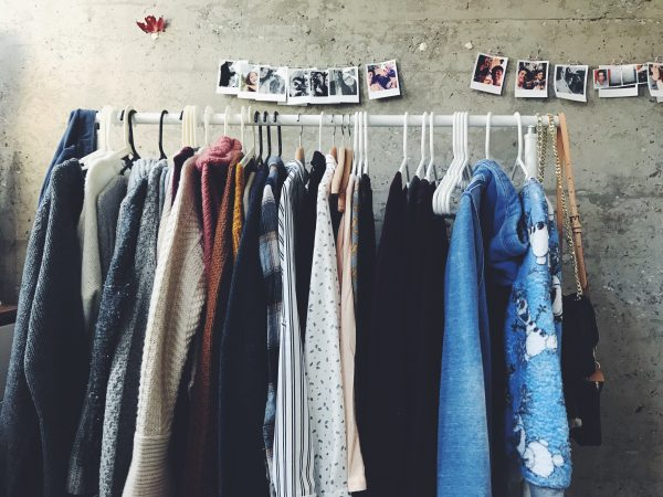 hygge clothing hanging on a clothes rack in an apartment