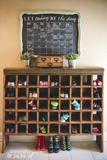 "vintage mail sorter shoe cubby with a chalkboard calendar that reads ""let today be the day"""