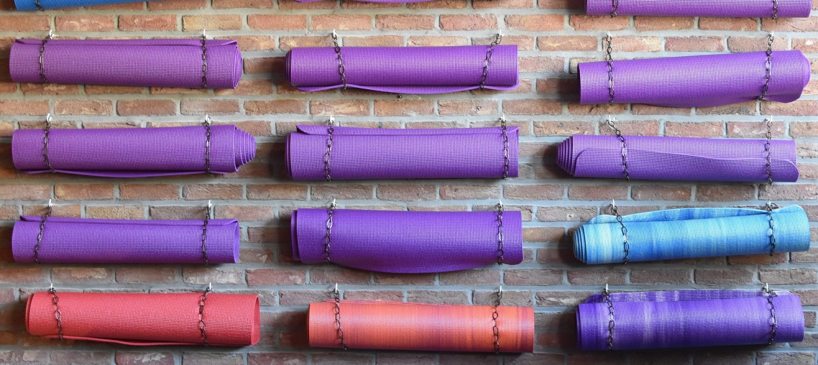 yoga mat storage on a brick wall