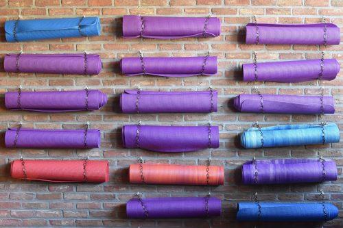 yoga mat storage on a brick wall