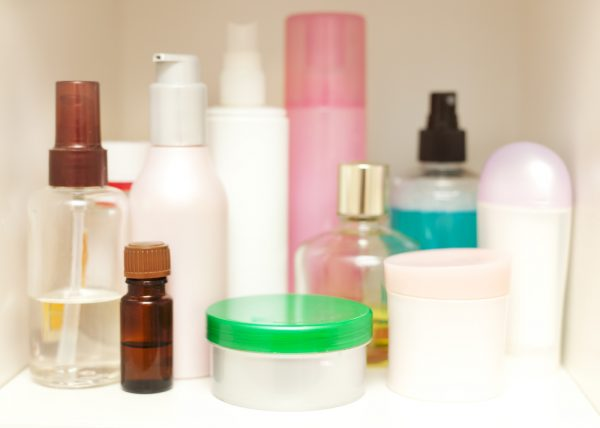 organized cosmetics and toiletries in a white bathroom cabinet