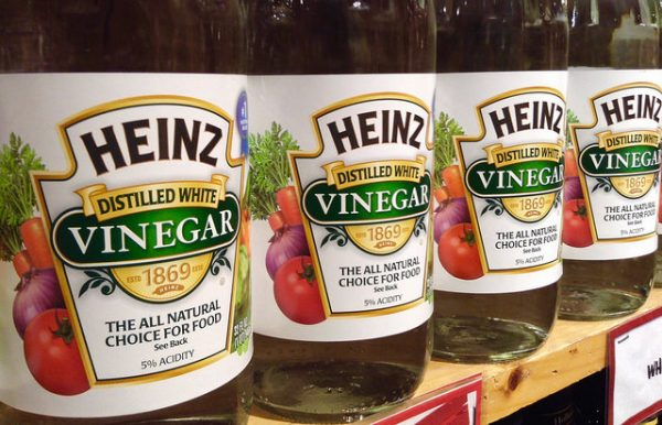 bottles of heinz distilled white vinegar on a store shelf