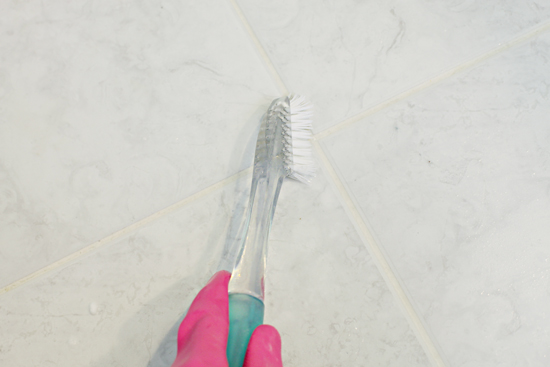cleaning grout with toothbrush by iheart organizing