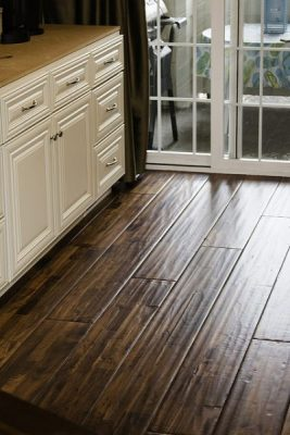 clean and shiny wood laminate flooring in a house