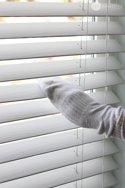 cleaning blinds with sock, vinegar, and water