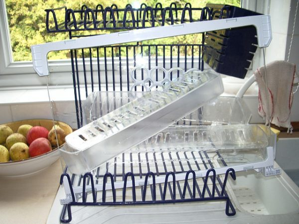 clean fridge shelves on a drying rack