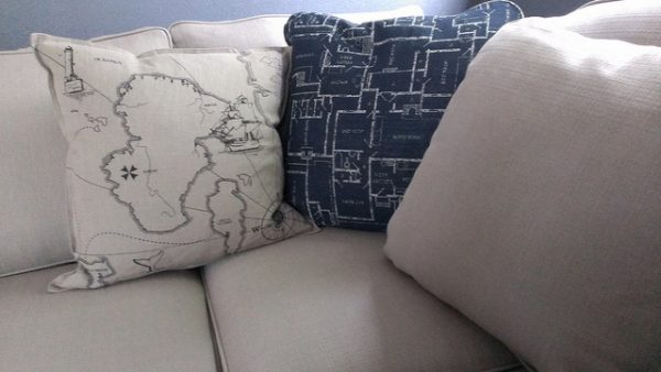 homespot hq decorative pillows on a clean sofa