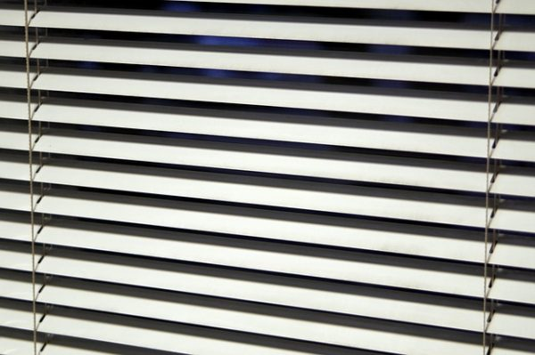 white window blinds facing downward