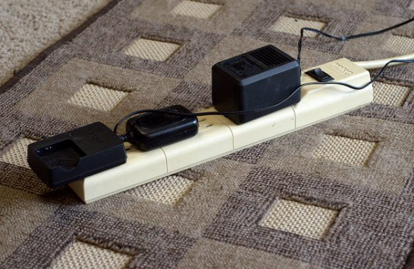 power strip with three chargers plugged in