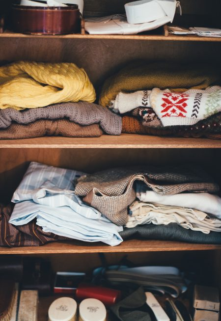 clothing and accessories on closet shelves