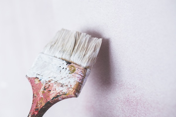 paint brush painting a wall white