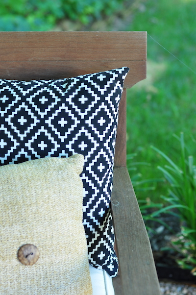 2 outdoor pillows on a fire pit chair designed by alison giese