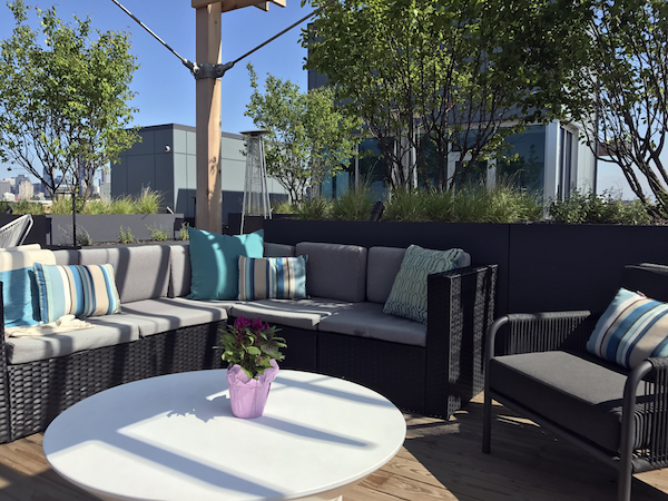 brianne bishop's luxe on chicago rooftop project includes an outdoor sectional, chair, and coffee table