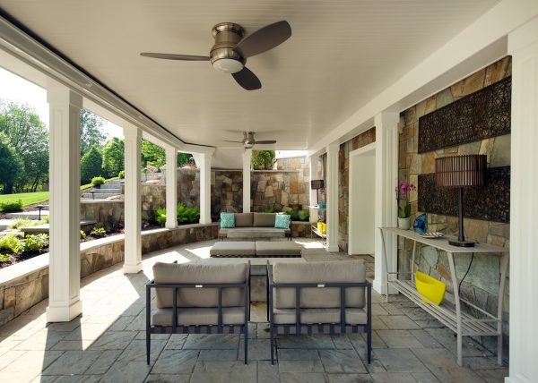 outdoor seating with cushions, an accent table, and a lamp designed by paola mcdonald