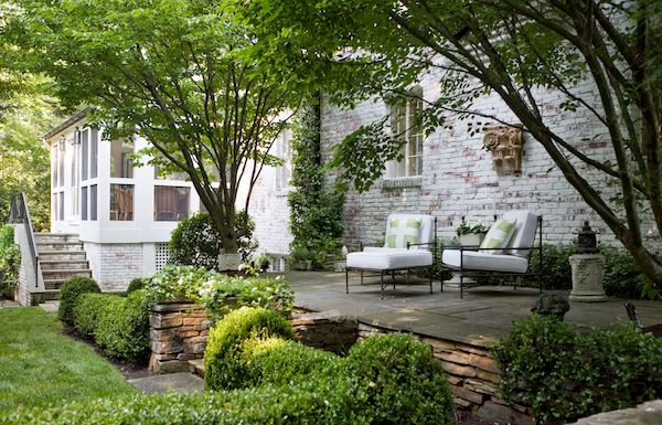 backyard patio with 2 outdoor chairs with cushions and throw pillows, designed by kelley proxmire
