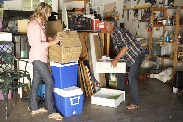 A man and a woman organize their garage together.