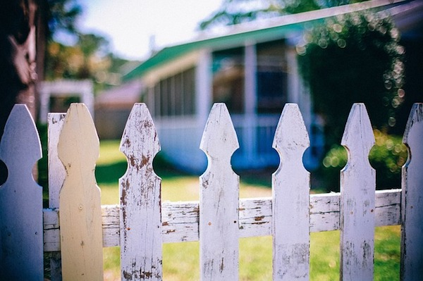 Closeup of a white picket fence