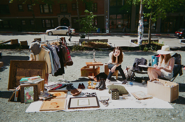 a woman looks overwhelmed by her yard sale