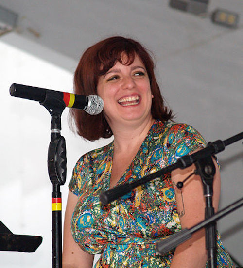 A photo of Sara Benincasa at a microphone