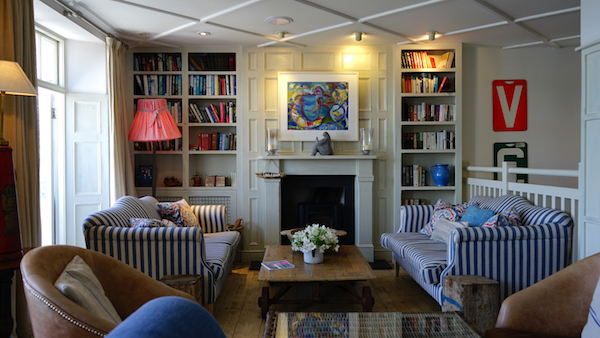 a living room with a big bookshelf