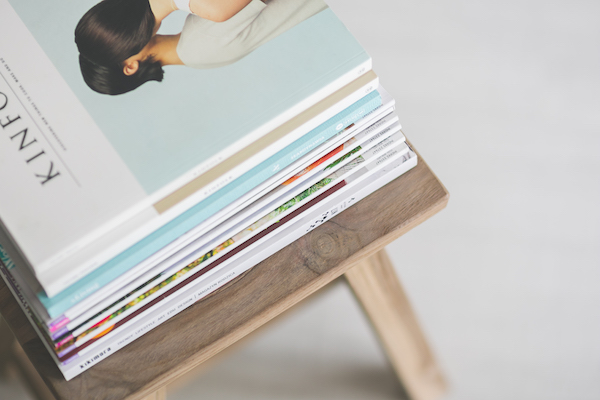 a pile of magazines on a coffee table