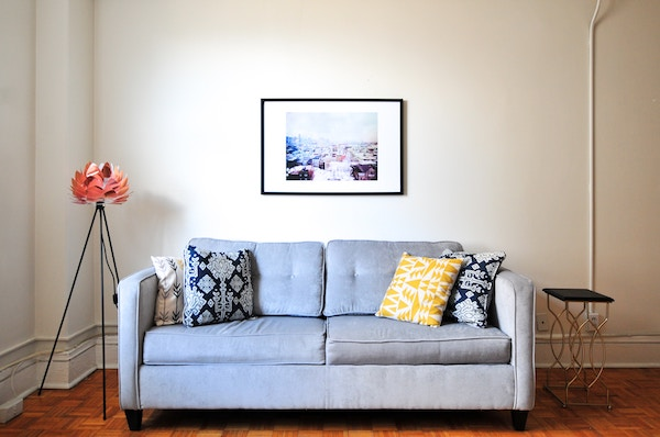 a well-lit room and a sofa