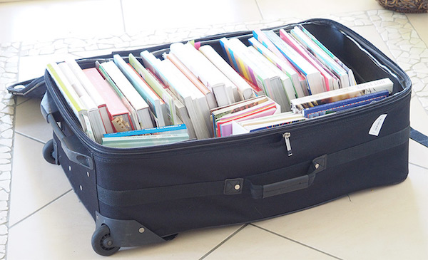 a collection of books inside a suitcase
