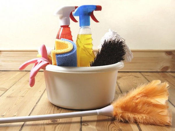 some cleaning supplies gathered in a bucket