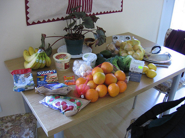a pile of groceries on a kitchen table
