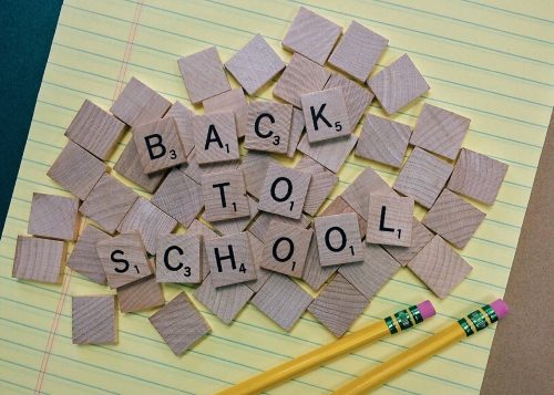 back to school organization tips and ideas scrabble tiles and 2 pencils atop a notepad