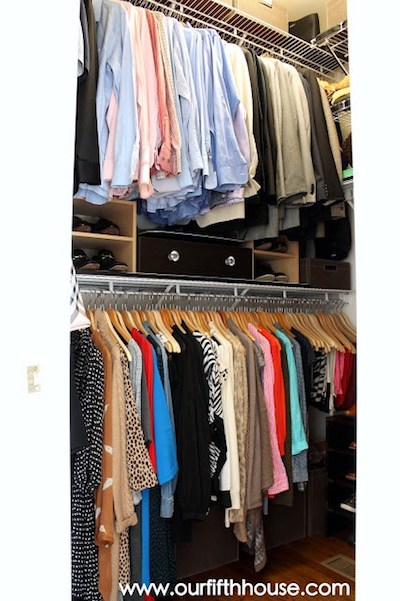 hanging clothes in an organized closet