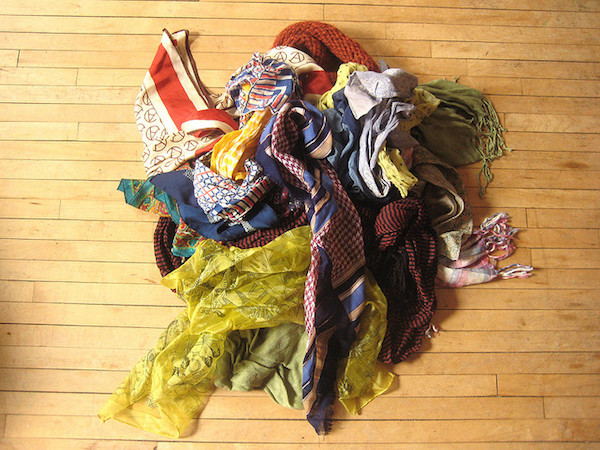 A collection of chic women's scarves on a wooden floor
