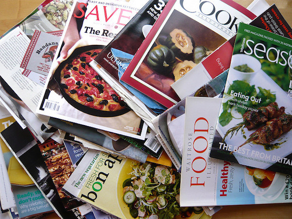 A sizable pile of old magazines like Food and Bon apetit