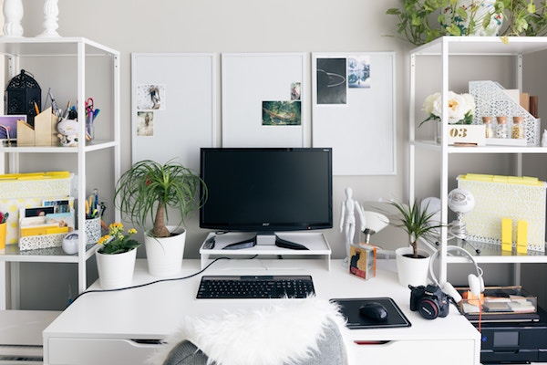 a big open desk with shelves on each side and plenty of tools and resources