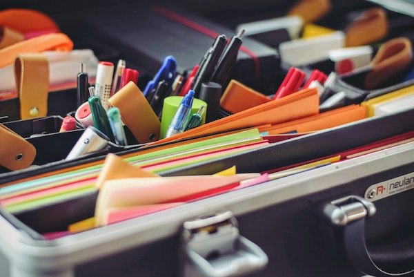 pens and files packed into a briefcase