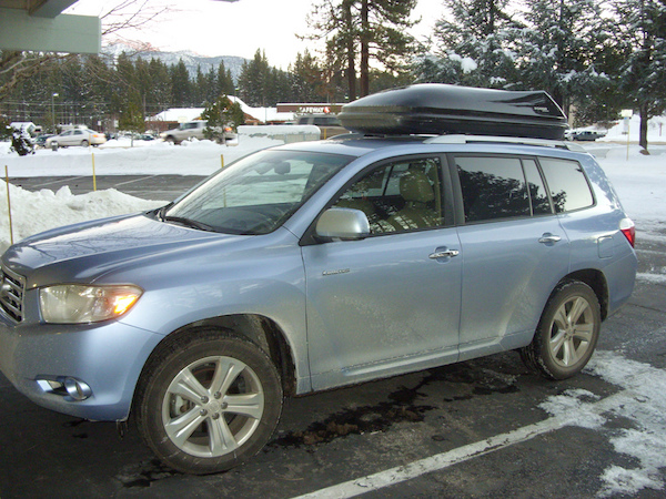 an SUV with a rooftop carrier during winter