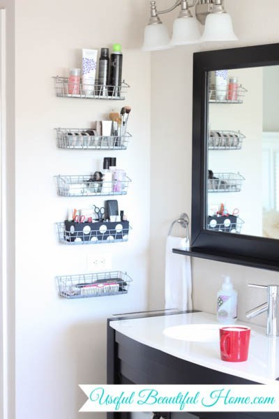 5 wire baskets mounted vertically on a white bathroom wall