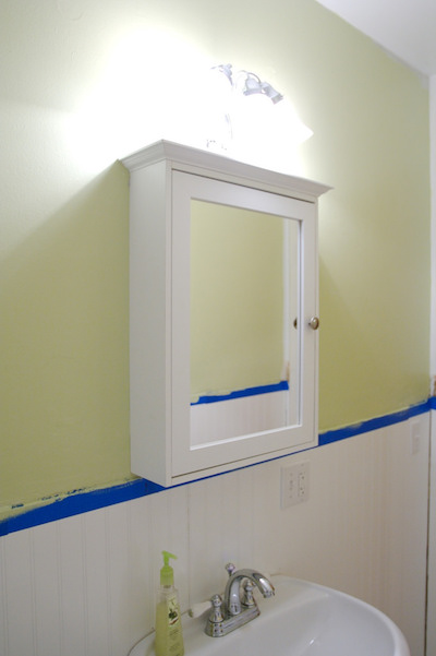 a white and wall-mounted DIY medicine cabinet with a mirror