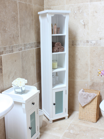 a narrow white corner bathroom shelving unit with a cabinet