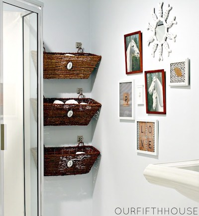 3 hanging wicker window box baskets storing towels and toiletries