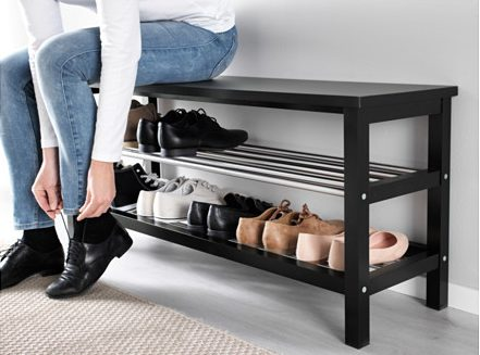 a black TJUSIG Bench with Shoe Storage from Ikea