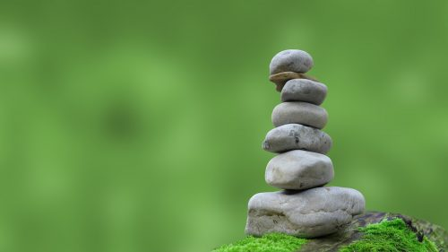 zen rocks stacked to increase positive energy and peace