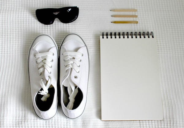 just the essentials shoes notebook sunglasses pencils