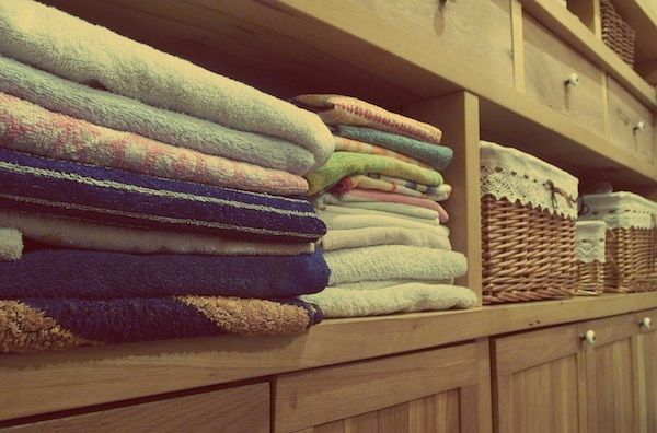 folded towels stacked in cabinet