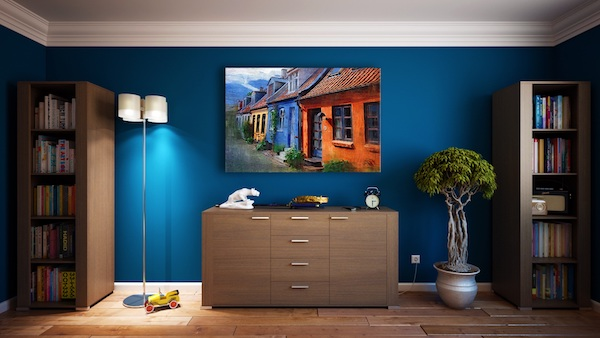 organized minimalist room with blue walls