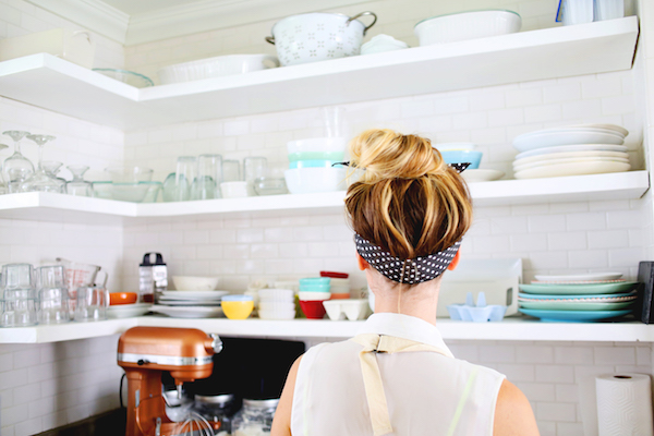 closeup of a woman who's wearing an apron in her kitchen