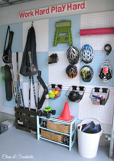 a pegboard hangs in a garage to organize sports gear