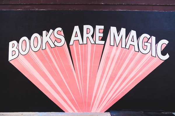 the mural outside the bookstore Books Are Magic
